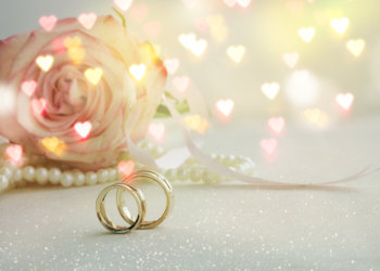 flower and wedding rings